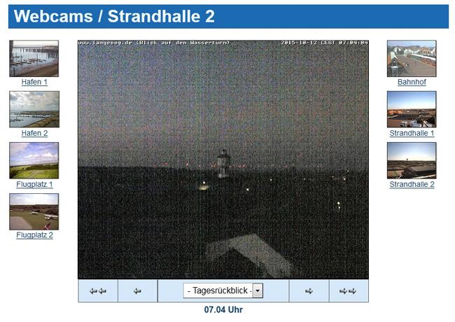 Die Küstenlinie bei Nacht, von LAngeoog aus gesehen: I, Hintergrund blinken hunderte Windkarftanalgen, am Tage weiße Blitze, nachts rotes Blinkfeuer (WebCam Langeoog)